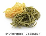 Nests of egg noodles and spinach - stock photo