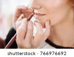 make up artist applying... | Shutterstock . vector #766976692