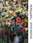 Small photo of Long exposure photograph of people in an art fair, studies fair, motion blur, moving people, crowd