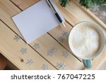 cup of coffee with a notebook... | Shutterstock . vector #767047225