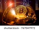 Small photo of Bitcoin in a soap bubble on video card background. Dangers and risks of investing to bitcoin. Speculation