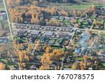 aerial view over the city | Shutterstock . vector #767078575