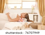 attractive young woman resting... | Shutterstock . vector #76707949