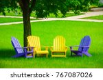 Four Vacant Adirondack Chairs ...