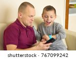 father and son happy getting a... | Shutterstock . vector #767099242