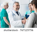 smiling confident doctor... | Shutterstock . vector #767125756
