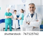 confident smiling doctor posing ... | Shutterstock . vector #767125762