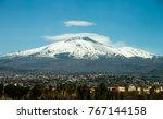 mount etna volcano with snow.... | Shutterstock . vector #767144158