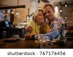 couple embracing in cafe | Shutterstock . vector #767176456