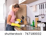 happy young woman cleaning... | Shutterstock . vector #767180032