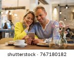 couple looking at smartphone... | Shutterstock . vector #767180182