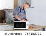 happy male serviceman using... | Shutterstock . vector #767182732