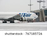 Small photo of Moscow, Russia - November 2017: Large wide-body passenger airliner Boeing 767 Utair airlines on the ground maintenance at Vnukovo international airport