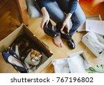 woman unboxing unpacking... | Shutterstock . vector #767196802