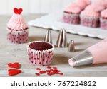 decorating red velvet cupcakes... | Shutterstock . vector #767224822