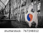 Small photo of South Korean Flag at the DMZ North South Korea border. Barbed wire and ribbons adore the fence separating the two countries