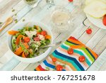 green salad with roasted garlic ... | Shutterstock . vector #767251678