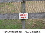 keep off sign on wood fence | Shutterstock . vector #767255056