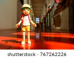 Small photo of BANGKOK, THAILAND - NOVEMBER 27, 2017: Miniature Yotsuba Koiwai anime figure standing in the hallway. It's famous Japanese comedy maga series.