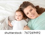 young mother and cute baby on... | Shutterstock . vector #767269492