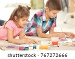 little children painting on... | Shutterstock . vector #767272666
