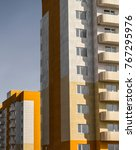 Small photo of Apartment buildings. Residential area. Social housing. Housing estate. High-rise building. Building fragment