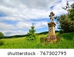 Old Stone Cross In Forest Of...