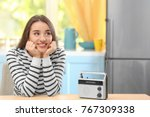 young woman listening to radio... | Shutterstock . vector #767309338