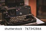 antique black typewriter with... | Shutterstock . vector #767342866