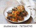 indian aubergine curry   gutti... | Shutterstock . vector #767364745