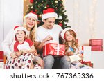 new year's photo of family at... | Shutterstock . vector #767365336