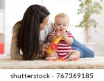 happy mother playing musical...   Shutterstock . vector #767369185