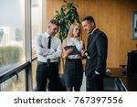 the employees of the firm are... | Shutterstock . vector #767397556
