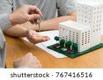 women taking keys from real...   Shutterstock . vector #767416516