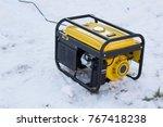 gasoline generator on snow | Shutterstock . vector #767418238