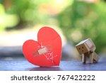broken red heart with sewed... | Shutterstock . vector #767422222