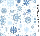 snowflakes background.... | Shutterstock .eps vector #767468356