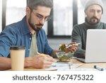 two corporative workers work... | Shutterstock . vector #767475322