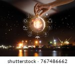 hand holding light bulb in... | Shutterstock . vector #767486662