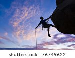 Rock Climber Rappells From The...