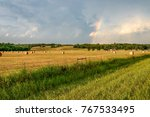 Rainbow Over A Hay Field In...