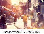 crowd of blurred shoppers... | Shutterstock . vector #767539468
