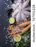 raw langoustine  mussels and... | Shutterstock . vector #767551228