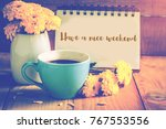 blue cup of coffee on wooden... | Shutterstock . vector #767553556