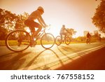 a woman is cycling into the... | Shutterstock . vector #767558152