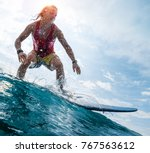 young surfer rides the ocean...   Shutterstock . vector #767563612