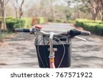 bike in the park. vintage tone. | Shutterstock . vector #767571922
