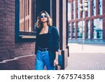 pensive female in sunglasses... | Shutterstock . vector #767574358