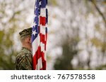 us army soldier with us flag at ... | Shutterstock . vector #767578558
