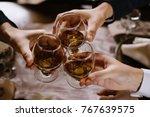 hands holding the glasses of... | Shutterstock . vector #767639575
